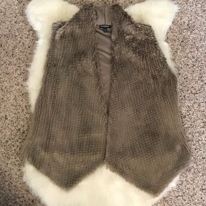 Soft! Worn once for pictures -Faux fur vest. Small